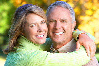 Happy couple with great teeth thanks to general dentistry