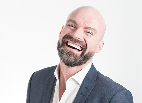Businessman smiling with his dental implants