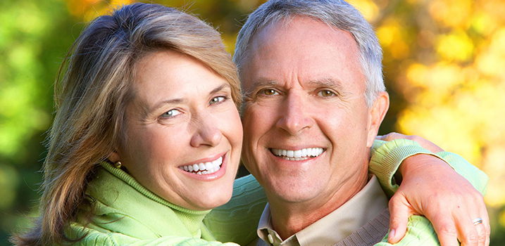 Happy couple with great teeth thanks to general dentistry.